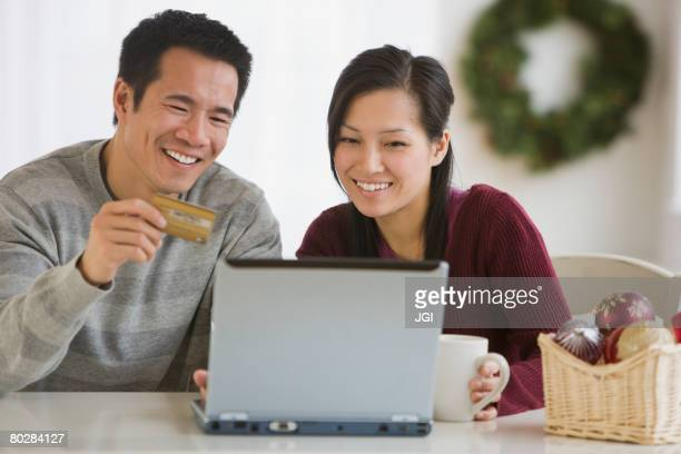 Asian couple shopping online