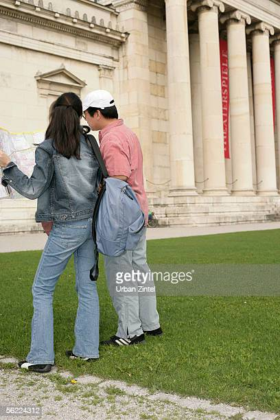 Asian couple standing in front of a museum