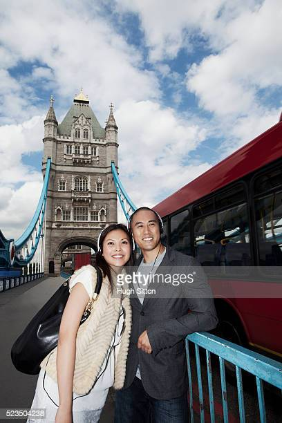 asian couple standing on tower bridge, london, england, uk - hugh sitton stock pictures, royalty-free photos & images