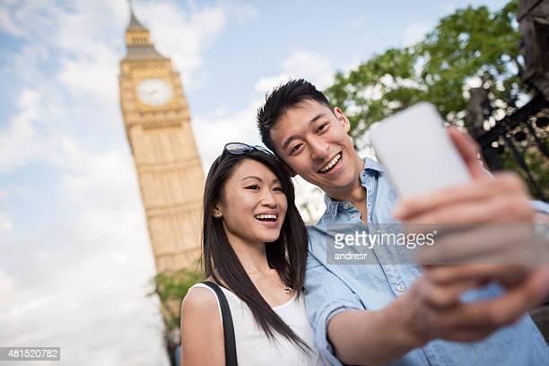 Asian couple taking a selfie in London