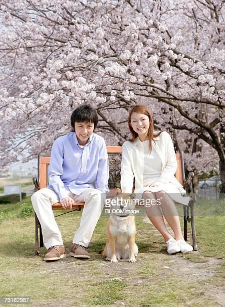 Asian couple talking under cherry tree