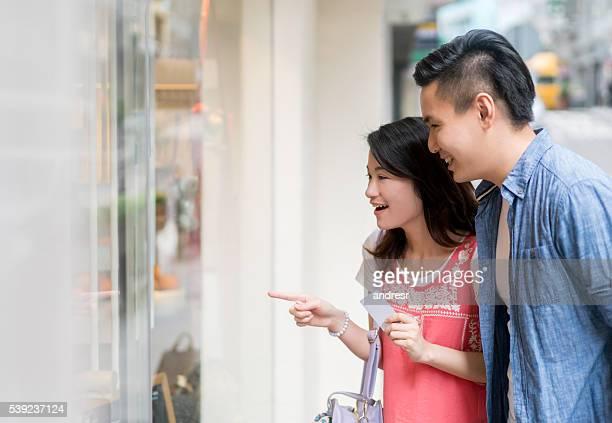 Asian couple window shopping