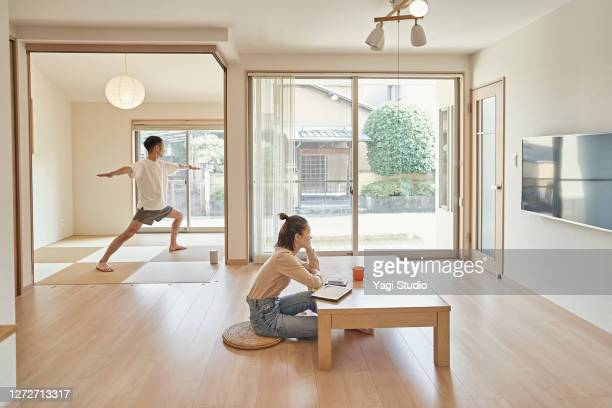 asian couples spend own free time at home. - wellness stock pictures, royalty-free photos & images