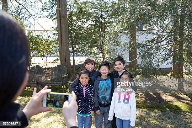 asian cousins playing in the backyard - scarsdale stock photos and pictures