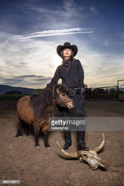Asian Cowgirl with Miniature Horse and Cow Skull