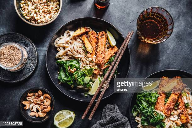 asian cuisine served on a table - asian food stock pictures, royalty-free photos & images