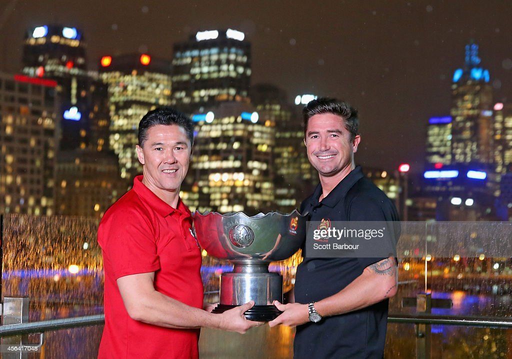 Asian Cup Ambassadors Alan Davidson and Harry Kewell pose with the Asian Cup at the Asian Cup Ambassador announcement on September 24, 2014 in Melbourne, Australia.