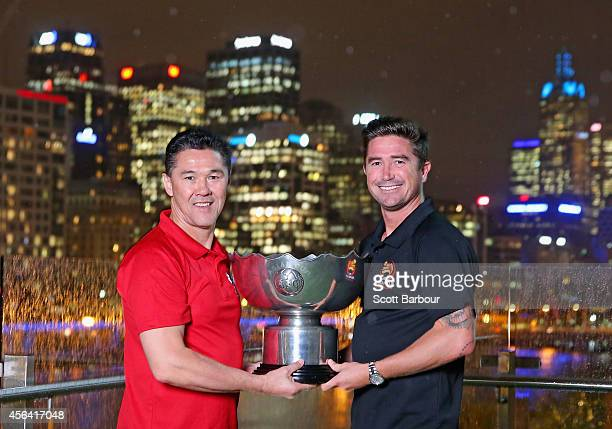 Asian Cup Ambassadors Alan Davidson and Harry Kewell pose with the Asian Cup at the Asian Cup Ambassador announcement on September 24 2014 in...
