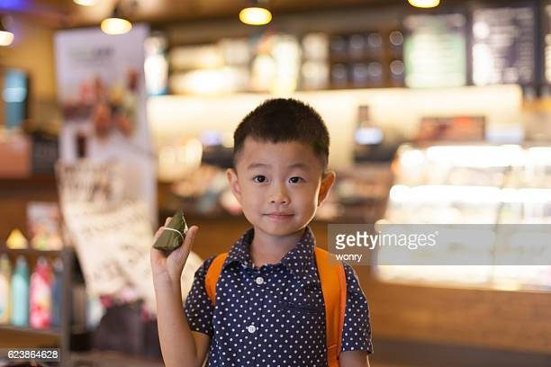 Asian cute child hold Chinese rice dumpling