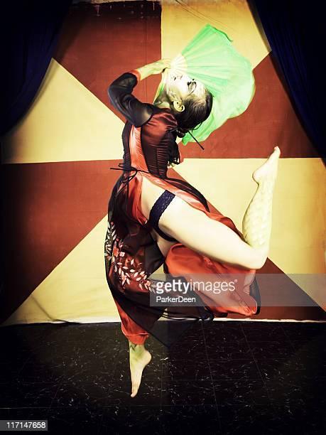 Asian Dancer with Green Fan Jumping