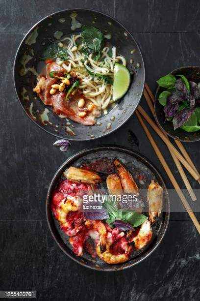 asian dishes for family dinner. - pho soup stock pictures, royalty-free photos & images