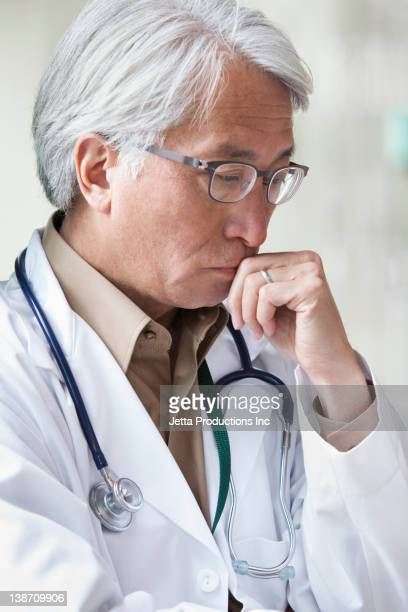 Asian doctor thinking