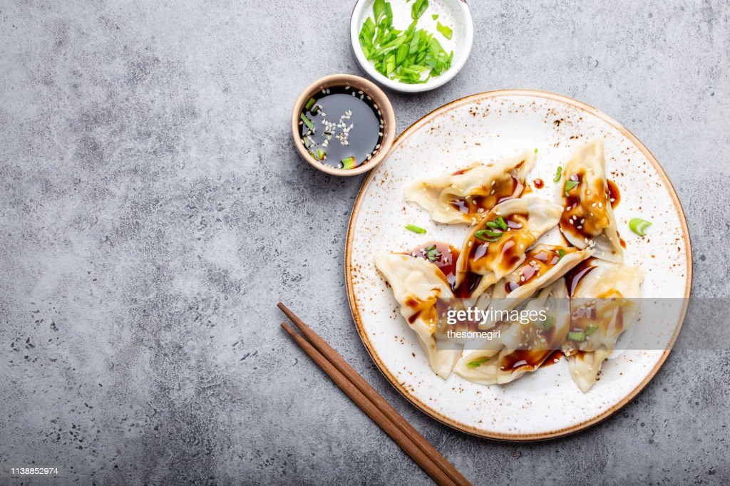 Asian dumplings on white plate : Stock Photo