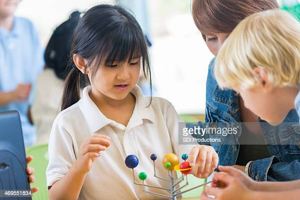 Asian elemenaty school student studying solar system in science class