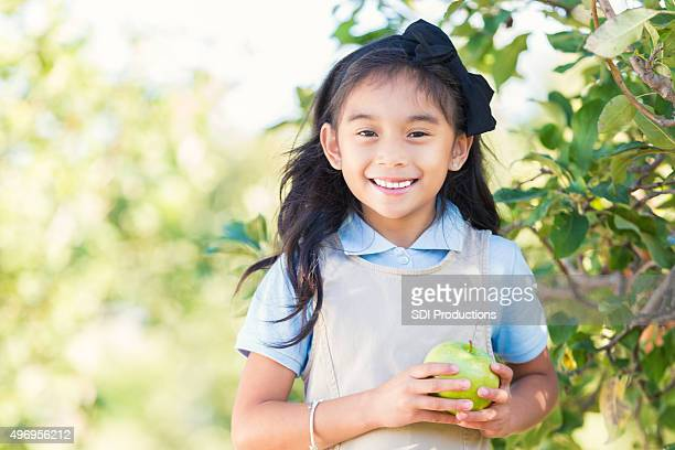 asian elementary student attending field trip at apple orchard - hair bow stock pictures, royalty-free photos & images