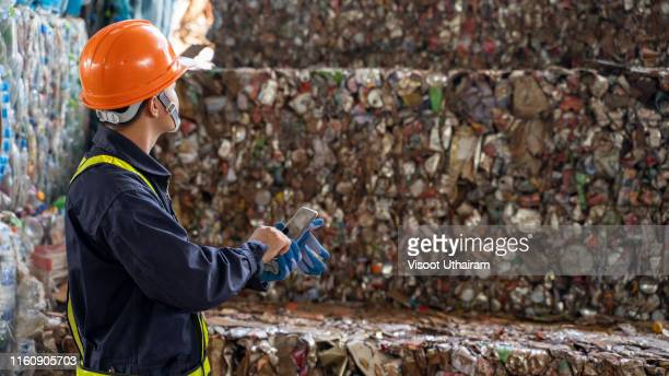 asian engineer checking the recyclable materials (waste). - landfill stock pictures, royalty-free photos & images
