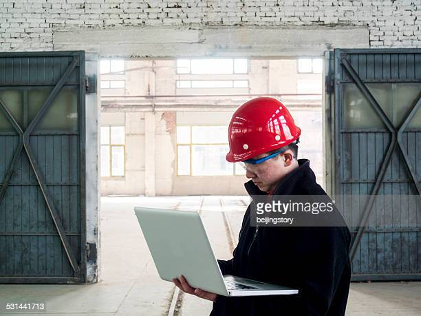 asian engineer working in factory