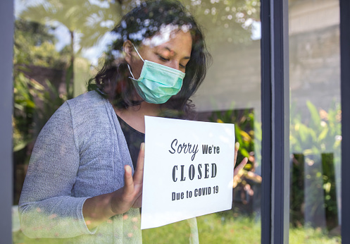 Asian entrepreneur closing business due to Covid 19 outbreak 1220064309