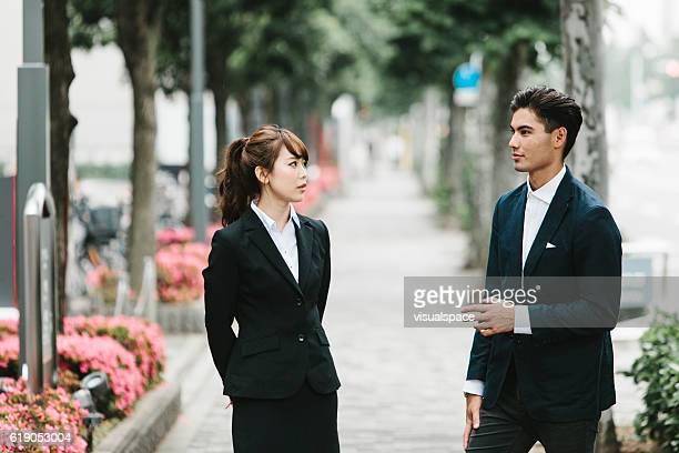 Asian Entrepreneurs Talking on the Street