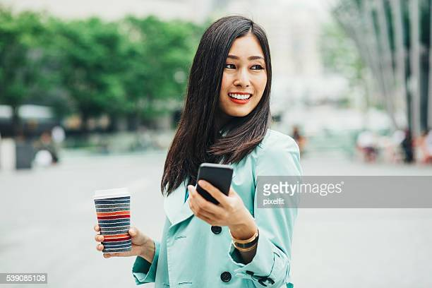Asian Ethnicity woman walking outdoors