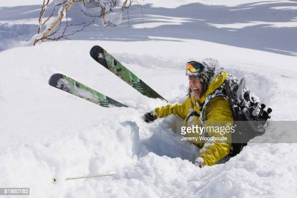 Asian falling in snow