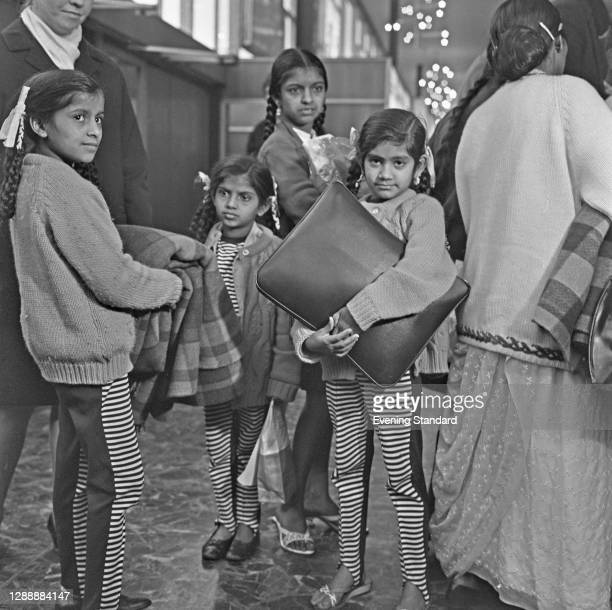 Asian families from Kenya arrive at Heathrow Airport in London, UK, 2nd March 1968. They are fleeing the country after being denied the right to buy...