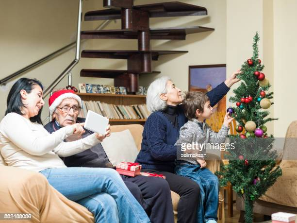 Asian Family Celebrating Christmas At Home