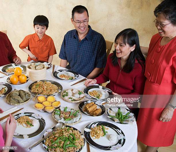 Asian family eating at dinner table