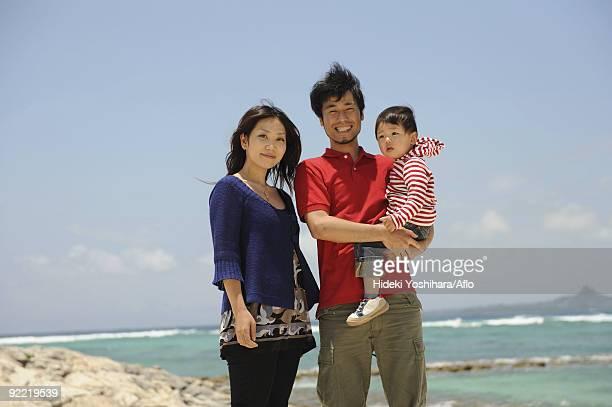 Asian family enjoying on beach