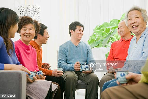 Asian Family gathering and sharing tea