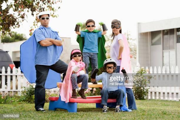 Asian family in superhero costumes