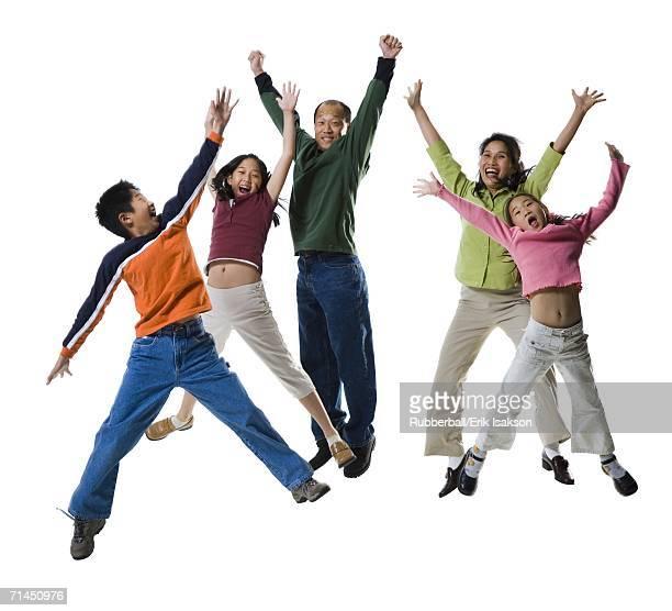 Asian family jumping