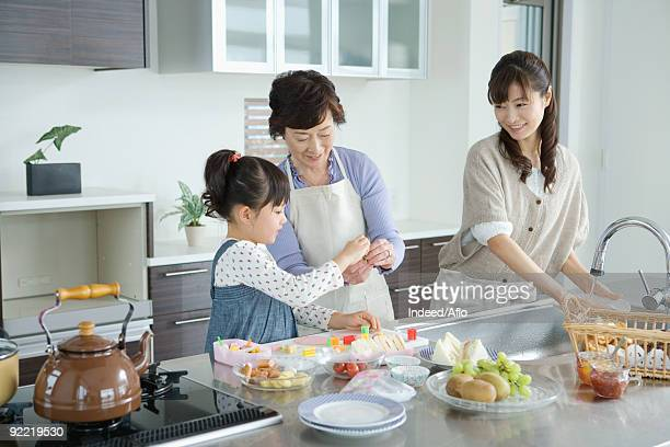 Asian family peparing breakfast in kitchen
