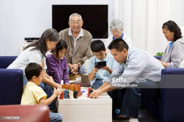 Asian family playing games together
