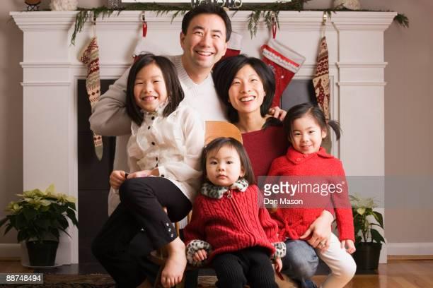 Asian family posing for Christmas photograph