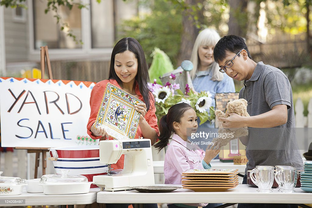 Asian family shopping at yard sale : Stock Photo
