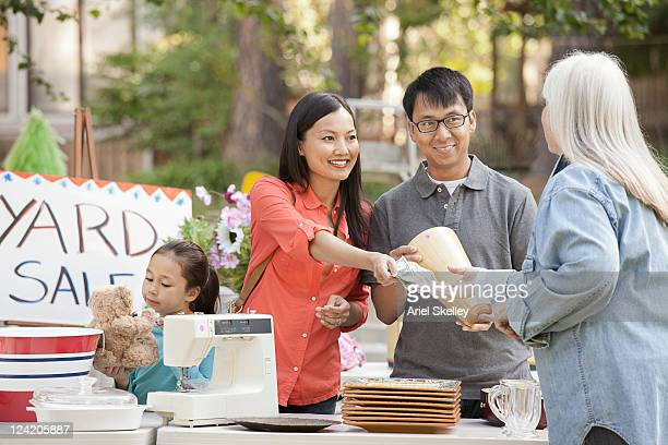 asian family shopping at yard sale - garage sale stock pictures, royalty-free photos & images