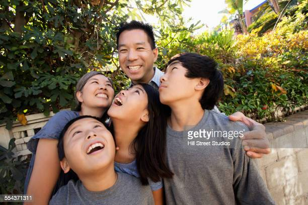 Asian family smiling in garden