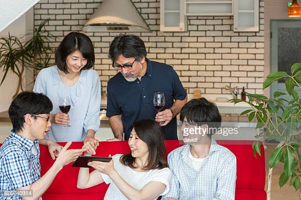 Asian Family With Adult Children Relaxing at Home