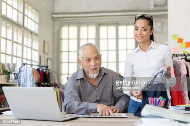 Asian fashion businessman working in modern office