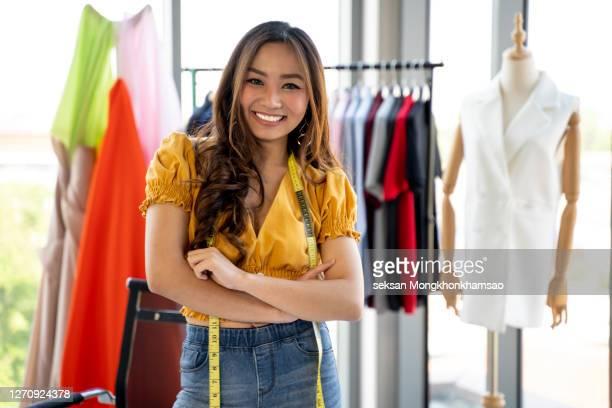 asian fashion designer sketching - fashion designer stock pictures, royalty-free photos & images
