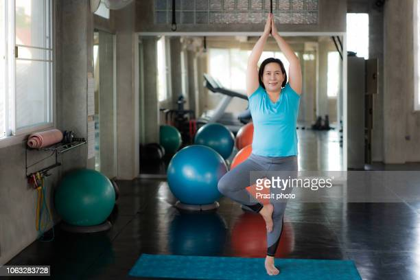 asian fat woman doing yoga exercise in gym. - fat asian woman stock pictures, royalty-free photos & images