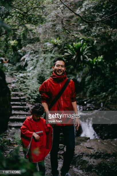 asian father and little girl hiking in rainforest, taiwan - taiwan stock pictures, royalty-free photos & images