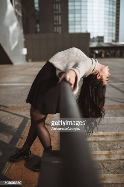 asian female beauty leaning and bending on stair railing outside - bending over in skirt stock pictures, royalty-free photos & images