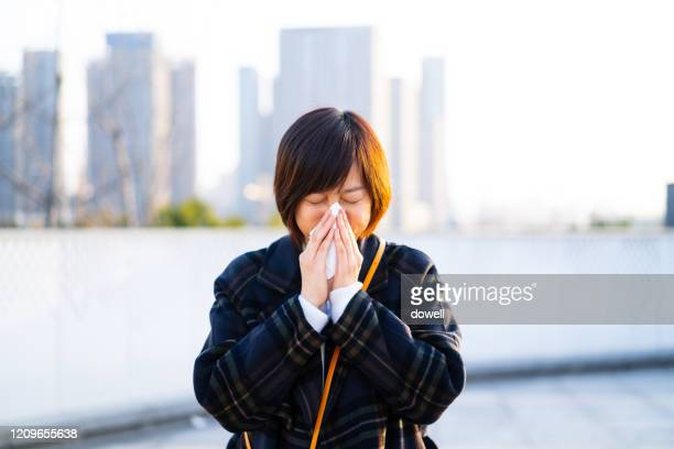 asian female blowing his nose - korea stock pictures, royalty-free photos & images