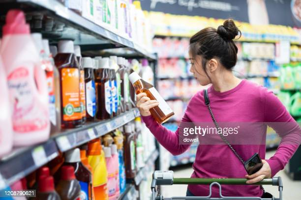 asian female buy  washing powder in supermarket - individual event stock pictures, royalty-free photos & images