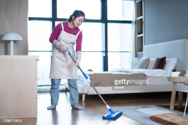 asian female cleaning floor with mop - メイド ストックフォトと画像