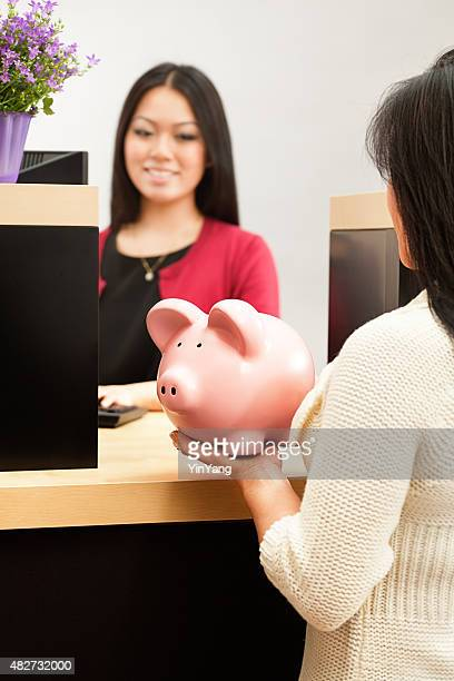 Asian Female Customer Opening Saving Account with Retail Bank Teller