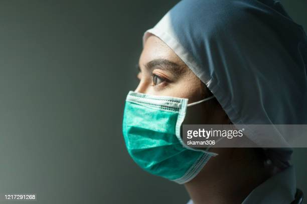 asian female doctor wearing surgical mask for coronavirus outbreak or covid-19, concept of covid-19 quarantine - sudden acute respiratory syndrome stock pictures, royalty-free photos & images
