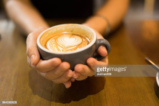 asian female feel relax and drink coffee - coffee drink stock pictures, royalty-free photos & images